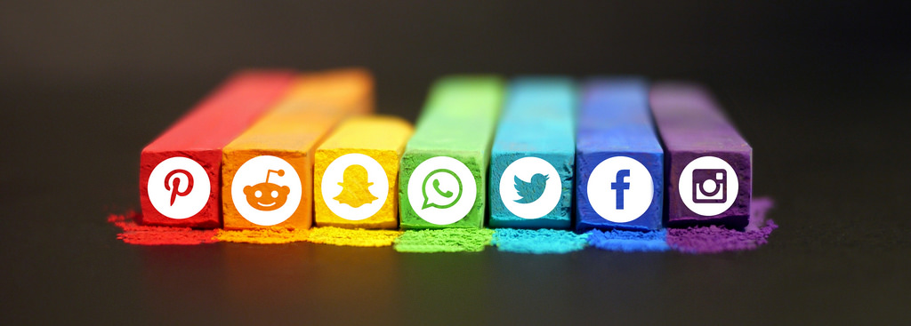 Image of chalk with social media icons on each colorful stick.